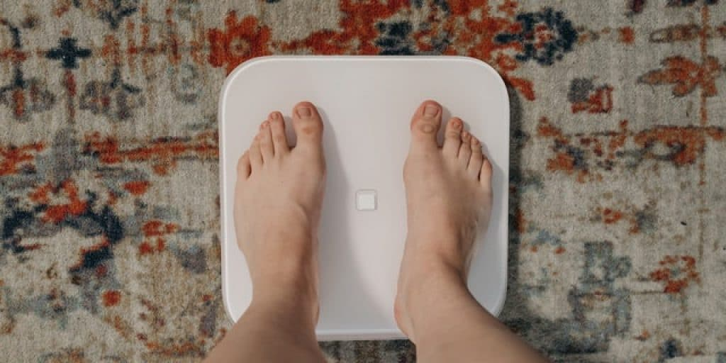 women thinking on weighing scale how to lose weight while on Lupron