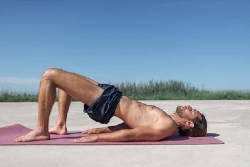 a man is doing pelvic tilt as mons pubis fat loss exercises