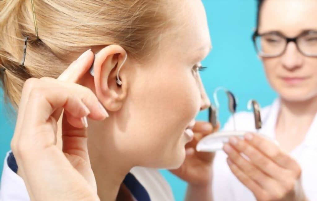 doctor helping to choose costco vs sam's club hearing aids