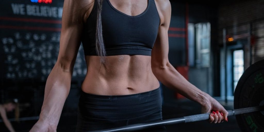 exercise helping woman to get BMI for abs