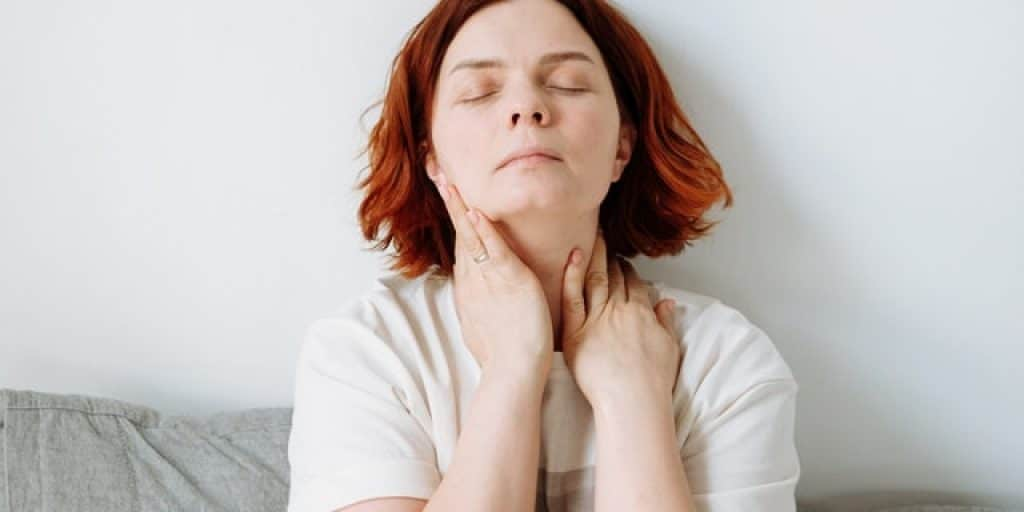 a woman feels like hair in throat
