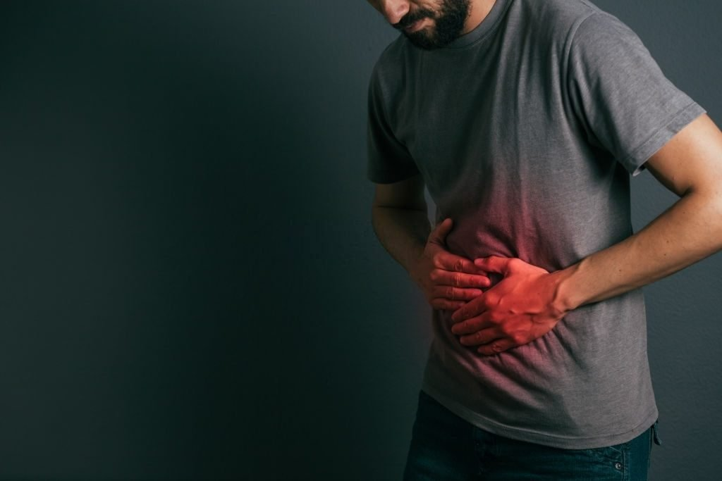 man worried about how to neutralize spicy food in stomach