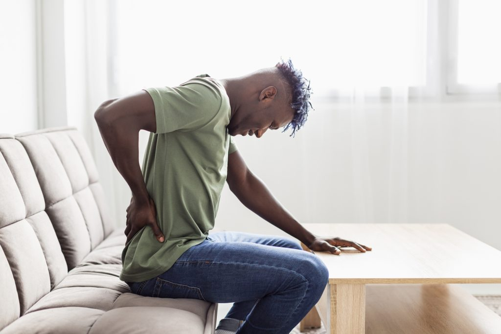 Back pain — pain in right side under ribs