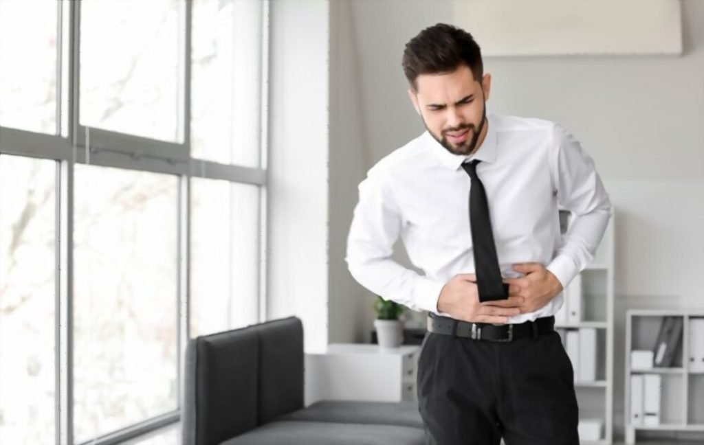 stomach pain when standing up